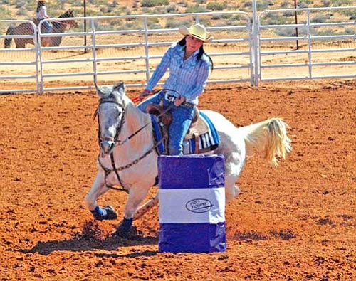 <i>Courtesy photo</i><br> Shoshanna Wilson maneuvers her horse around a barrel during the Senior Girls Barrel Racing competition at the Wester Agency Summer Series rodeo April 11.