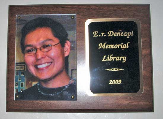 "<i>Courtesy photo</i><br> A wall plaque bears a photo of Er Denezpi to comemmorate the ""Er Denezpi Memorial Library"" at CollegeAmerica. Staff and students at CollegeAmerica held a library dedication ceremony last week to honor Denezpi, who passed away late last year."