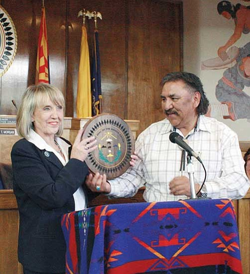 <i>Photo by Joshua Lavar Butler</i><br> Arizona Gov. Jan Brewer attended the Navajo Nation Council's 2009 spring session April 20 in Window Rock. Pictured is Navajo Council Speaker Lawrence T. Morgan presenting Brewer with a carved plaque of the Navajo Nation seal.