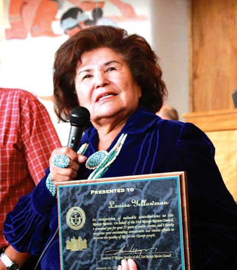 <i>Photo by Joshua Lavar Butler</i><br> Retired Coconino County Supervisor Louise Yellowman was honored with a plaque for her 27 years of public service by the Navajo Nation Council during its 2009 spring session.
