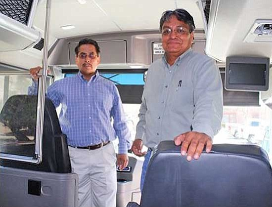 <i>Photo by Joshua Lavar Butler</i><br> Virgil Brown, division director for Navajo Division of General Services and Lee Bigwater, department manager for Navajo Transit System.