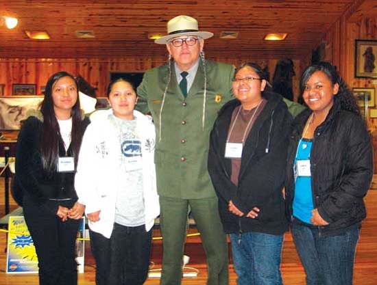 """<i>Photo by Stan Bindell/NHO</i><br> Gerard Baker, superintendent of Mt. Rushmore National Park, is sandwiched by Hopi High radio students. They are, from left, Geraldine """"Honlets"""" Numkena, Melsena Harris, Baker, Darian """"Barbarian"""" Poleyestewa and Latoya Rucker."""