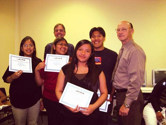 "<i>Photo by Stan Bindell/NHO</i><br> Hopi High radio students display their state awards. They are (from left) Kamille ""Kandy"" Kane, Hopi High Principal Glenn Gilman, Darian Poleyestewa, Geraldine Numkena, Paul Quamahongnewa and Superintendent Paul Reynolds."