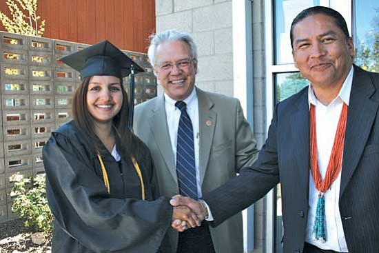 New CCC graduate Cristina Linn (left), her uncle District 2 Rep. Tom Chabin (center)  and Diné College President Ferlin Clark celebrated CCC's commencement on Friday. Clark's nephew was a CCC graduate as well.