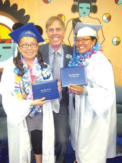"<i>Photo by Stan Bindell/NHO</i><br> Hopi High Principal Glenn Gilman sandwiched by graduates Diana ""D"" Fernando and Tarrah Tewanema."