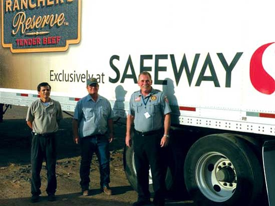 <i>Courtesy photo</i><br> Navajo County Sheriff K.C. Clark (at right) and Navajo County staff dropped off 5,400 gallons of water at the Dilkon Police Department on July 15. From left to right are Greg Duran, Holbrook Safeway general manager; Jack Brooks, road yard supervisor; and Sheriff Clark.