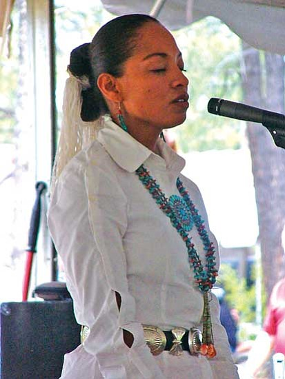 "<i>S.J. Wilson/NHO</i><br> Always a crowd pleaser, former Miss Navajo Nation Radmilla Cody closes her eyes as she sings ""Tears,"" a song highlighting the pain of domestic abuse."