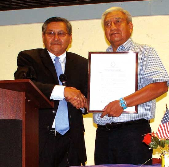 """<i>Photo courtesy of NN-OPVP</i><br> Navajo Nation Vice President Ben Shelly presents a proclamation declaring the second week of October as """"Navajo Nation Disability Awareness Week"""" to Hoskie Benally, chairman of the Navajo Nation Advisory Council on Disabilities."""