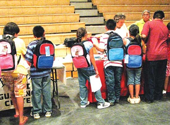 <i>Christian Bigwater</i><br> Students gather at a recent event in Tuba City where they were given brand new backpacks and school supplies, thanks in part to efforts by the National Backpack Program and Navajo Nation Council Delegate Hope McDonald LoneTree. About 4,000 backpacks were given to students throughout the western Navajo Nation.