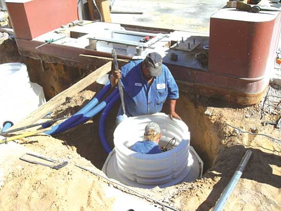 The co-op store at Hotevilla is being assertive in coming early into compliance with EPA standards to upgrade and convert to new gasoline safety standards. Here, a crew from EPA regulated petroleum services install new underground petroleum storage tanks.