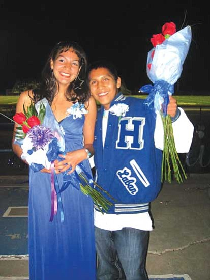 "<i>Stan Bindell/NHO</i><br> Desire Torivio and Ronnie ""Mr. Cross Country"" Laban smile proudly for the camera after being crowned homecoming queen and king for Hopi High School. Hopi beat Pinon 52-22."