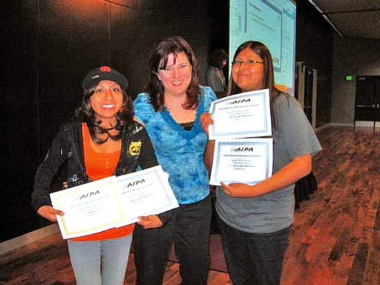 "<i>Stan Bindell/NHO</i><br> Jaysana ""Wink Wink"" Honyaktewa and Darian ""The Barbarian"" Poleyestewa receive their radio awards from an Arizona Interscholastic Press Association official."
