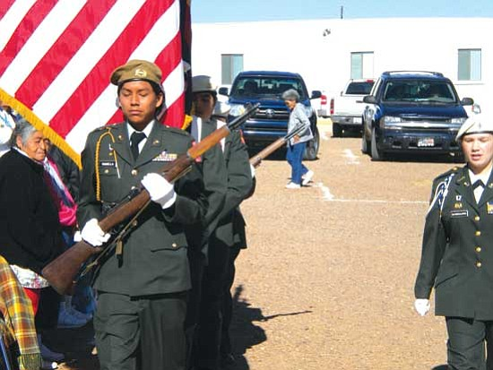 The Honor Guard members march as they present colors at the event.