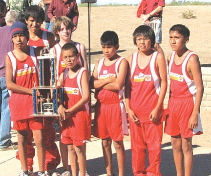 The Tuba City Boarding School Thunderbirds boys' cross country team displays a trophy. Pictured from left to right are: Kyle Hardy, Yazzie Goodman, Eddie Loughran, Lance Fuller, Albert Fuller, Triston Yellowman, and Kyle Sumatzkuku.