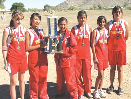 The Tuba City Boarding School girls cross country team smile after winning their second straight state title at the Junior High State cross country meet on Oct. 31 in Goodyear. Pictured from left to right are: Brianna Loughran, Ashley Onsae, Andrea Dodson, Nikita Greymountain, Tamera Beaver, and Dorshanna Coolie. Not pictured is Kahijah Posey.