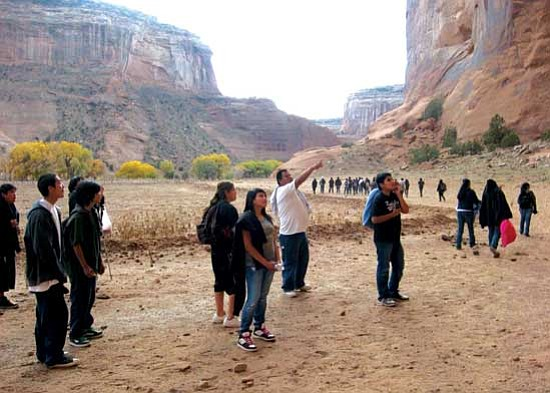 <i>Courtesy photo</i><br> Carson, a guide for Antelope House Tours points out some pictographs to Greyhills Academy students. Pictured from left to right are Michael Robbins, Oakley Yazzie, Tommy Hicks, Viola Yazzie, Shannon Tsinagine, Carson and Branden Becenti.
