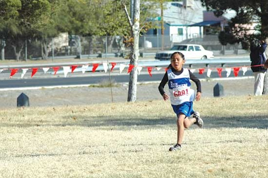 First-year club runner Jaeda Honani, age 8 qualified in the girls Bantam division (10 years old and under).