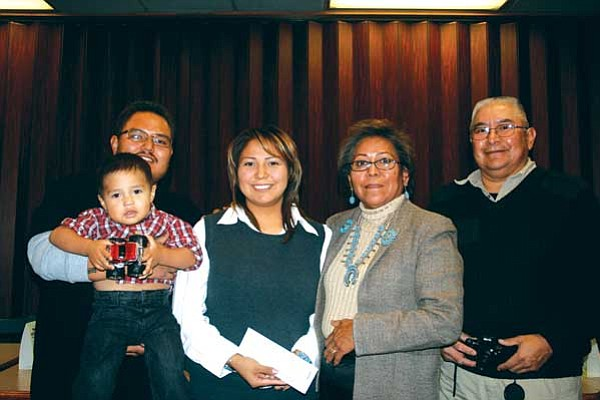<i>Courtesy photo</i><br> Dellynn Wilson's family gathers to congratulate her: From left to right: son, Jaython Williams (being carried); husband, Jeremy Williams; Dellynn Wilson; and parents, Linda Wilson and Lawrence Begay.