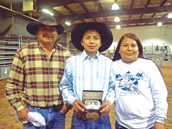 <i>Photo courtesy of Chris Puente Sr. family</i><br> Raylando Puente (center) and his parents, Chris Sr. and Flora Puente at the National Finals Bull Riding Championship of the NJBRA in Shawnee, Okla.