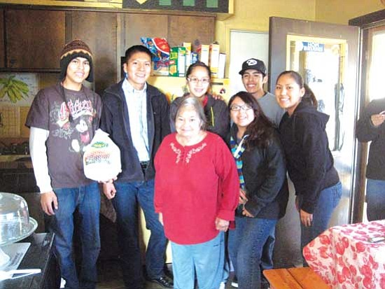 "Hopi elder Emma Koopee (center) is surrounded by Hopi High NHS students. They are (from left): Truman Nuvakuku, Brannon Sidney, Sharmayne Mike, Justin ""Vava J"" Secakuku, Meagan Laban and Torri Youvella."