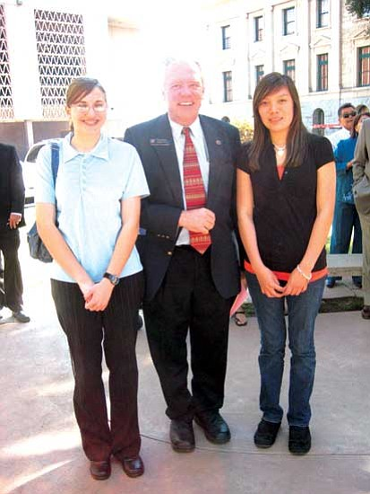 <i>Stan Bindell/NHO</i><br> Arizona State Rep. Tom Chabin with Hopi High students Hayley Keith and Brook Namoki.