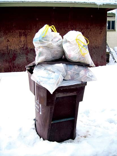 Household trash has not been picked up for two weeks st Hopi. The solid waste trucks are having difficulty reaching homes to pick up trash bins due to road conditions. As a result, household trash is being scattered and eaten by wild animals and dog packs.