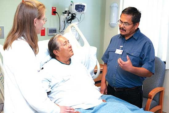 <i>Courtesy photo</i><br> Interpreter Marvin Cody (right) helps Navajo patients understand their physicians' instructions.