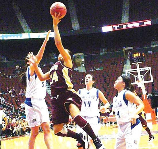 <i>Anton Wero/NHO</i><br> Winslow's Paige Shirley (34) goes for a lay in against Safford's Bea Villalba (50). Winslow defeated Safford by a score of 44 to 41 during the Arizona State Class 3A semifinal game at the Jobing.com Arena in Glendale.