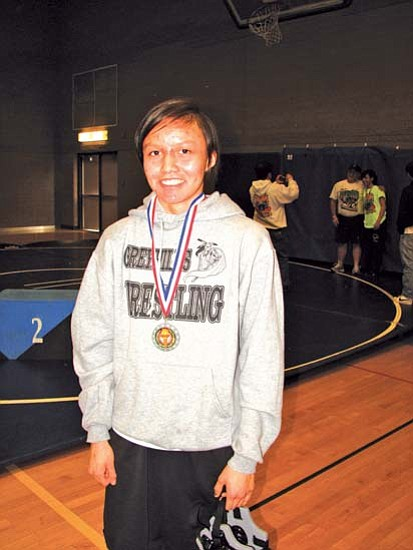 <i>Courtesy photo</i><br> Four-time Arizona Girls State Wrestling Champion Francita Bitah of Greyhills Academy High School poses with her championship medal.