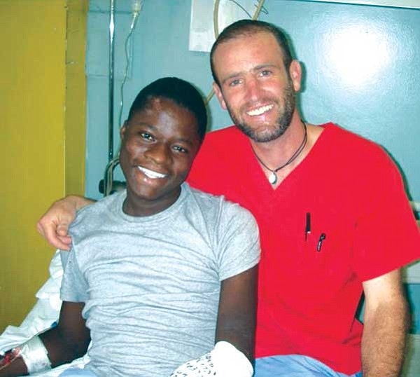 <i>Courtesy photo</i><br> Darren Blue with a patient.