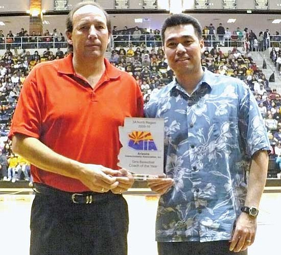 <i>Anton Wero/NHO</i><br> Grey Perkins, of the Holbrook Lady Road Runners, and Charles Chong, of the Window Rock Lady Scouts, were voted 2009-2010 Co-Coaches of the Year for the Arizona 3A Girls North Region.