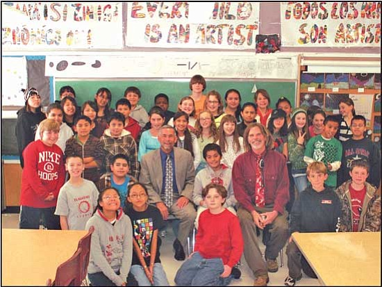<i>Courtesy photo</i><br> County Attorney David Rozema poses with Adan Deniz and his winning class at Puente de Hozho Magnet School in Flagstaff. His teacher, Mr. Bowie, received a $300 award to be used for classroom purposes, and his entire class will be going to the Phoenix Art Museum on an all-expense paid field trip later this spring.