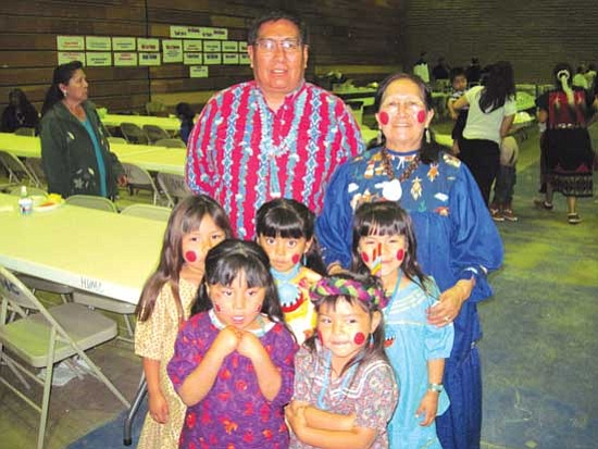 "Members of the talented ""Konina"" dancers from Second Mesa Head Start class stand with teacher aide Oran Selestewa (left) and teacher Rethema Honyouti. In all, there were 20 students from the class at the event.<br /><br /><!-- 1upcrlf2 -->"