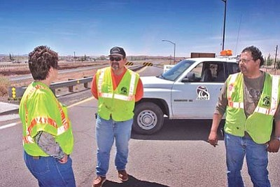 <i>Todd Roth/NHO</i><br> Supervisor Frances Perkins, Lomel Pato, Rick Sedillo of ADOT discuss the closure of I-40 in Winslow.