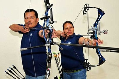 <i>Photo by Ed McCombs</i><br> Duane Hanley and Samantha Yessilth, Diné College Archery Team members take aim at academic and athletic achievement.