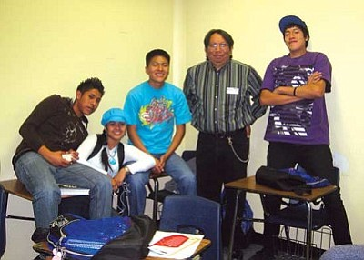 <i>Stan Bindell/NHO</i><br> NAJA executive director Jeff Harjo poses with Hopi High radio students.