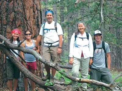 <i>Stan Bindell/NHO</i><br> Arizona Highways Editor Robert Stieve (center) likes to get out on trails such as this one on the San Francisco Peaks. But now he's working to save Arizona's state parks.