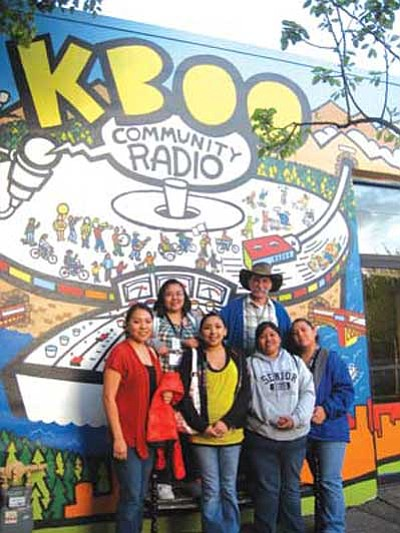 "<i>Stan Bindell/NHO</i><br> Hopi High students stand in front of the colorful mural at KBOO radio station. From left are (top row): Gerri Sehongva and radio/journalism teacher Stan Bindell; (bottom row) chaperone Carrie Joseph, Rebecca Talayumptewa, LeAnna ""LeLe"" Leyva and Patrese ""Tree"" Honie."