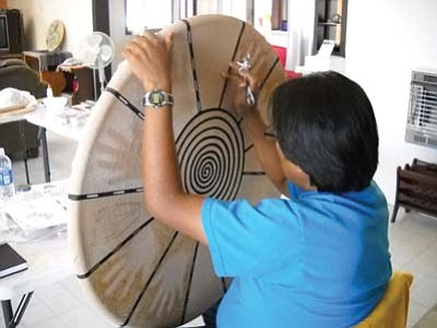 <i>Rosanda Suetopka Thayer</i><br> 2009 Hopitutuqaiki art student Carliss Sinquah works on a piece required for completion of his art school course. Small size and personal attention is what makes this school a major success.