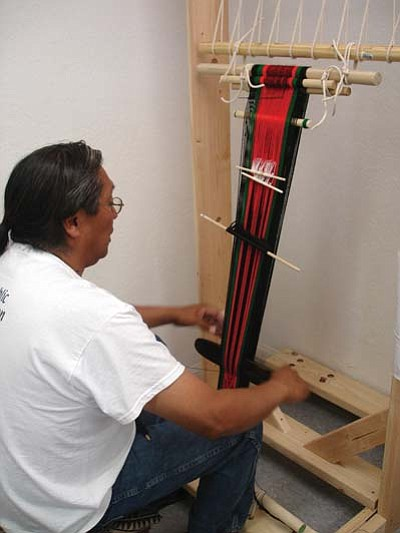 <i>Rosanda Suetopka Thayer</i><br> Rod Poneoma, a 2009 Hopitutuqaiki art school graduate, works on a piece that is a true traditional Hopi art form — Hopi belt-weaving.  Classes for Hopitutuqaiki start next week.