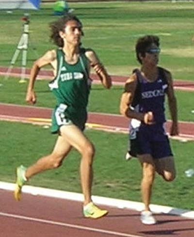 "<i>Photo by Carl Perry</i><br> Tuba City's Billy Orman (left) and Sedona's Jesus Rivera ran the ""race of the day"" on May 15. Orman and Rivera ran neck and neck during the final 100 meters of the 1,600 m run. After an amazing photo finish, Orman was declared the winner by a mere 2/100ths of a second with a time of 4:20.03 over Rivera's 4:20.05."