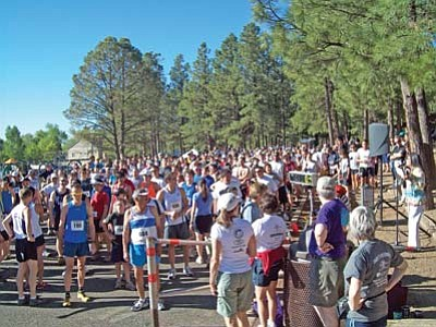 <i>Courtesy photo</i><br> Runners gather at the start of the 27th Annuan Sacred Mountain Prayer Run held in Flagstaff on June 5. The run is part of the Northern Arizona Trail Runners Association (NATRA), a six-series race held in Flagstaff each summer. What makes this run special is the reverence held by all participants for the sacred mountain and for all forms of life.
