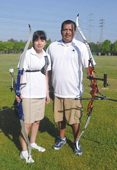<i>Courtesy photo</i><br> Diné College archers Georgia Sandoval and Duane Hanley competed at the 2010 U.S. Collegiate Archery Association (USCAA) National Championships held recently at College Station, Texas. Sandoval was named Best New Archer in the ladies recurve division while Hanley took All-Academic.