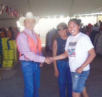 <i>Tyler Tawahongva/NHO</i><br> Miss Western Navajo Petra Tsosie (at right) shops for western wear at the Navajo Arts and Crafts Enterprise tent sale held in Kayenta over the July Fourth holiday weekend.