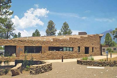 "<i>Photo by Jim Roberts</i><br> Exterior of the Museum of Northern Arizona's Easton Collection Center. According to MNA Director Robert Bruenig, the building was purposely constructed to have ""an east-facing entrance to greet the sun every morning; a circular shape to invoke the cycles of life; and connections to the natural world with its living roof, appropriate use of day-lighting, local materials whenever possible, and views of the sacred San Francisco Peaks from both inside the building and out."""