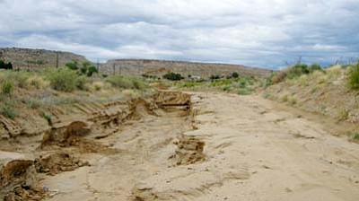 <i>Tyler Tawahongva/NHO</i><br> Severe flooding in recent days has caused extensive damage to sewer and water systems as well as roads in the Polacca area. Hopi Tribal Chairman LeRoy Shingoitewa and the Navajo County Board of Supervisors issued a state of emergency for the area last week as scattered thunderstorms are expected to continue this week.