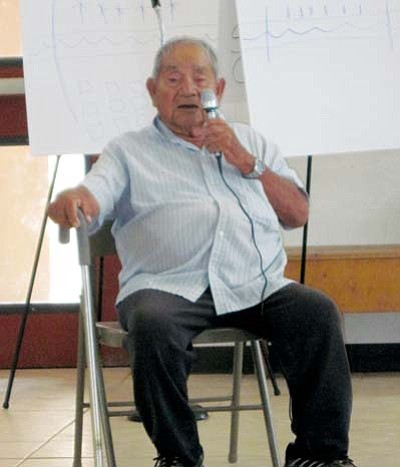 <i>Rosanda Suetopka Thayer/NHO</i><br> Neil Monongya, an elder from Hotevilla Village shares his knowledge of water, the sacredness of the earth and reservation lands with the crowd at the COALition Forum.