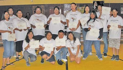 <i>Tyler Tawahongva/NHO</i><br> Youth participants pose with their certificates after completion of the Hopi Lavayi Institute's summer Hopi language immersion program. The program introduced non-Hopi speakers to language immersion, which better enables students to become accustomed to hearing the language.
