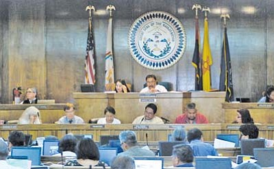 <i>Courtesy photo</i><br> Joe Engelken, Chief Executive Officer (CEO) of Tuba City Regional Health Care Corporation (bottom row, second from left); Sally Pete, CEO of Winslow Indian Health Care Center; and Council Delegate Thomas Walker (Birdsprings/Leupp/Tolani Lake) were present when the Navajo Nation Council passed legislation allowing Title 1 health care contractors to enter into Title V status under the Indian Self-Determination Act (P.L. 93-638).