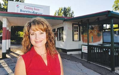 "<i>Submitted photo</i><br> Brenda Felsing stands outside the Burrito Burger, located at 1924 Arrowhead, just off of Route 66. Felsing is hopeful that her new establishment, featuring comfort foods from her home state of New Mexico will offer ""a one of a kind taste experience that's easy on the pocketbook."""
